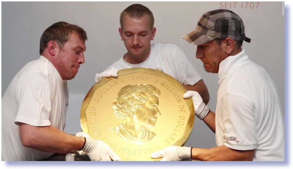Apl17-Canada Million dollar coin - 3 guys holding it.jpg