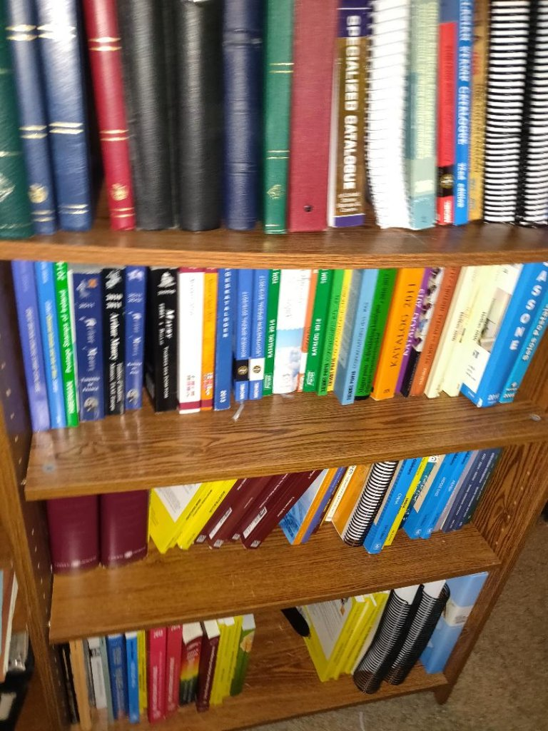My Hard Copy Philatelic Library (apologies for the blurry pic from cellphone)